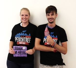 GACC South staff Britta Lipke and Manuel Muhl wearing the 2013 finisher shirt of the Peachtree Roadrace.